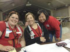 Volunteers Jennifer Milbourn, Megan Justine, and Jasmine Su at the Rim Fire Shelter.