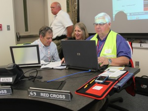 Volunteer Bob Eger (R) works with Robin Friedman of the Red Cross (L) and Kris Nelson of Sacramento OES in the EOC.