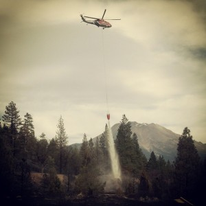 Helicopter makes a water drop on the Boles Fire in Weed, CA