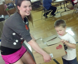 Kari's daughter, Kayla and grandson Carson, help to stock the kitchen.