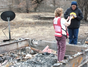 Debbie helps Tiffany search through the ashes for any belongings.