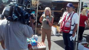 Vietnam Veteran and Red Cross volunteer Dennis Bartell helps out during June's 'Operation Care Package'