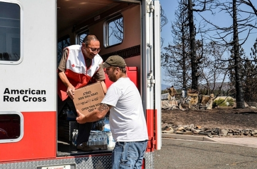 Volunteer Freddy Aw helps deliver relief supplies to residents of Weed, CA following September's Boles Fire.