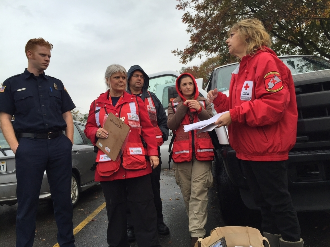 Debbie Calcote (R) provides direction for Red Cross volunteers during a recent fire safety canvassing event in Turlock, CA.