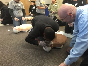 George instructs a student on providing rescue breaths.