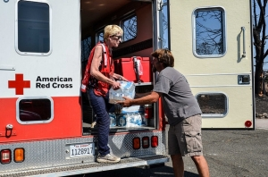 Volunteer Carrie Reilly delivers water and supplies to residents impacted by 2014's Boles Fire in Weed, CA.