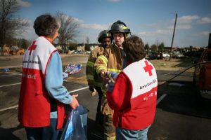 Emergency Response Vehicle drivers Vicki Oczkowicz and Brenda Clampitt hand out snacks to firefighters at Union University, Jackson, Tennessee.