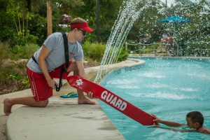 Used for the 2014 Aquatic Attraction Lifeguarding course presentation and other materials related to this course.  Pictures depict lifeguards in a waterpark setting demonstrating the skills needed for lifeguards to get certified to work in this environment. Photo by Michael Del Polito/American Red Cross © Stock photo taken for the American Red Cross