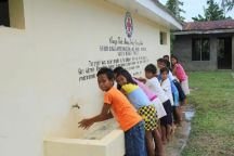 September 3, 2015. Tolosa, Leyte, Philippines. Children in Tolosa wash their hands at San Vicente Elementary School. The American Red Cross and Spanish Red Cross installed this running water in the aftermath of Typhoon Haiyan, which damaged and destroyed houses, schools, and infrastructure in its path. Photo by Niki Clark/American Red Cross