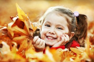 little-girl-in-fall-leaves