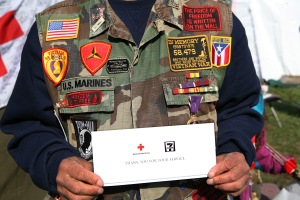 A Vietnam War veteran is thanked for his service with free coffee and donut coupons, provided by 7-Eleven, at the Red Cross tent on the National Mall.