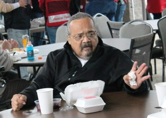 Joe Avila sitting at a table eating at a Red Cross shelter.
